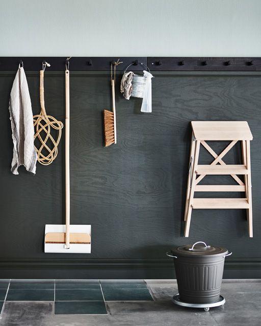black wooden wall, blue wall, hooks, grey flor