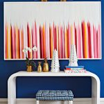 Bright Entrance, Blue Wall, White Console Table, Brown Patterned Floor, Pink White Painting