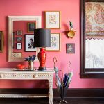 Bright Entrance, Pink Wall, Wooden Floor, Colorful Rug, White Console Table, Mirror, Paintings