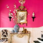 Bright Entrance, Wooden Floor, Pink Wall, White Wainscoting, Black Stairs, Chandelier, Shelves, Console Table