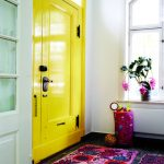 Bright Entrance, Yellow Door, White Wall, Black Floor, Purple Pattern Rug And Mat