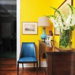 Bright Entrance, Yellow Wall, Wooden Floor, Wooden Cabinet, Blue Chair