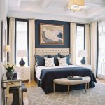 Chic Bed Sets Blue Wall Chandelier Artwork Blue Bedding Curved Bench Gray Rug Windows Tufted Headboard Pillows Table Lamps White Nightstands White Curtains Mirrored Console Table