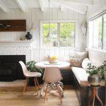 Dining Corner, Black Wooden Bench, White Cushion, White Wooden Plank Wal, White Wooden Beams, White Round Table, Cream Modern Chair, Black Fireplace