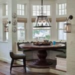 Dining Corner, Round Window Bay, Wooden Roudn Table, White Bilt In Bench, Dark Grey Cushion, Black Metal Pendant, White Subway Tiles