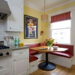Dining Nook, White Corner Bench, Red Cushion, Yellow Wall, White Framed Window, Wooden Table, Pendant