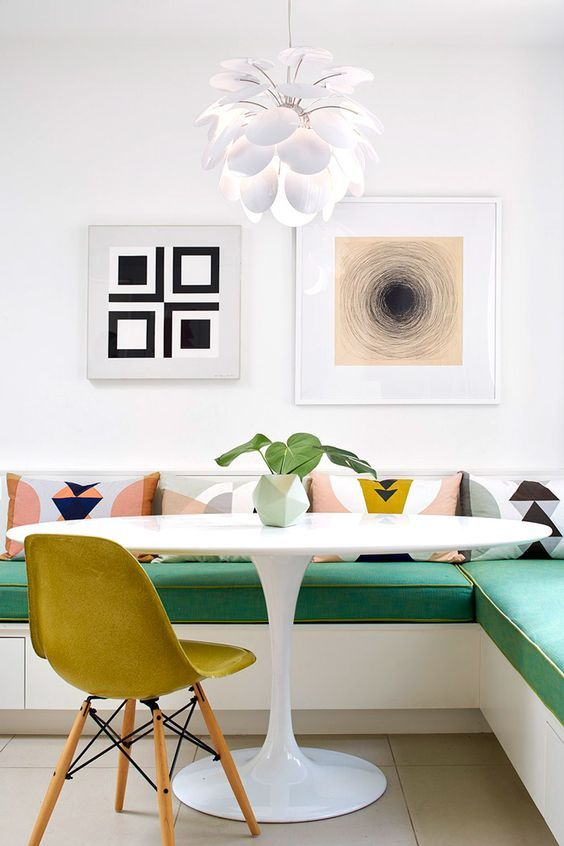dining nook, white floor, white bench, green cushion, white table, yellow modern chair, white pendant
