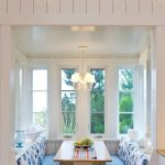 Dining Nook, White Wooden Wall, White Wooden Benches, Wooden Table, Blue Cushion, White Blue Cushion, Sconces