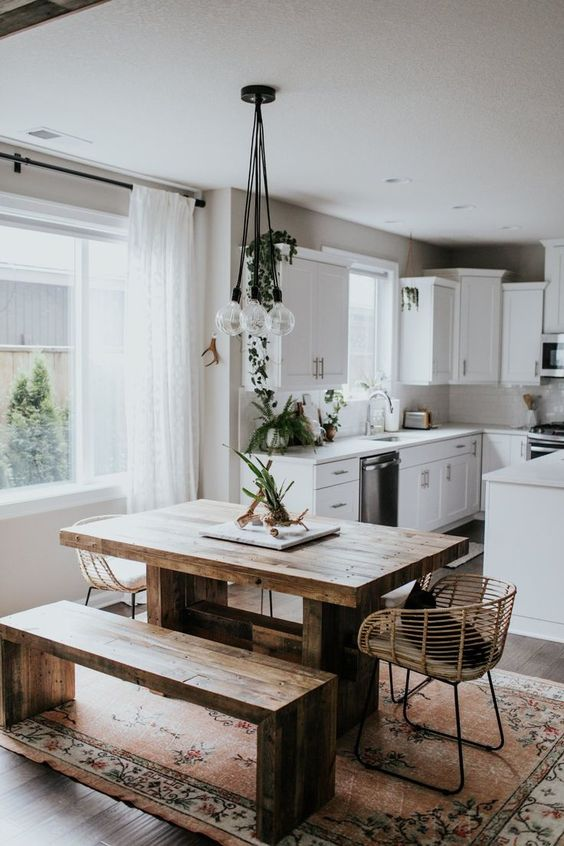 dining room, block wood table and bench, rattan chair, clear bulbs pendants, white bottom cabinet