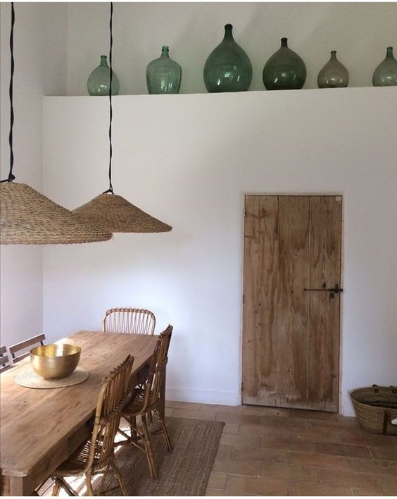 dining room, brown floor tiles, white wall, wooden dining table, rattan chair, rattan pendant