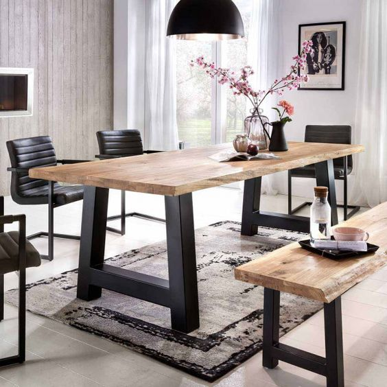 dining room, grey floor tiles, black metal table and bench with wooden top, black chairs, grey rug