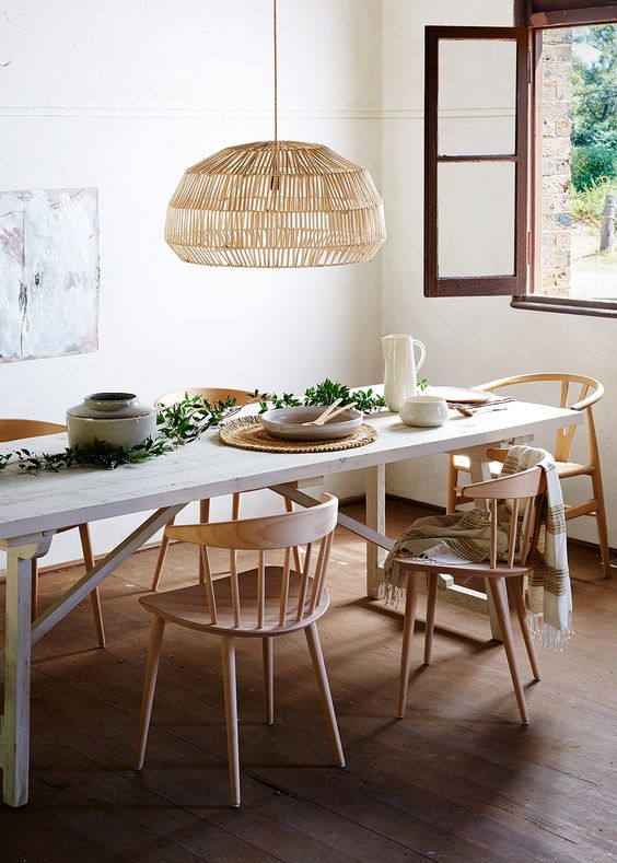 dining room, wooden floor, white wall, white wooden table, wooden chairs, rattan pendant