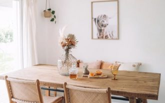 dining room, wooden floor, wooden table, rattan chairs, rattan pendant, white wall, red rug