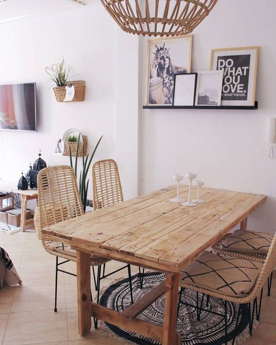dining room, wooden table, rattan chairs, brown floor tiles, black round rug, rattan pendant