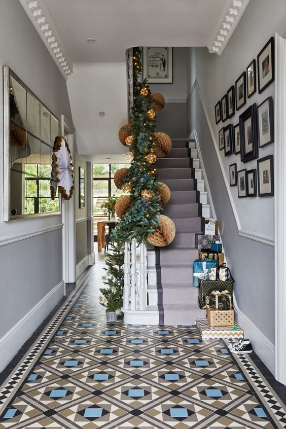 entrance foyer, black blue brown patterned floor tiles, grey wall, grey stairs, white ceiling