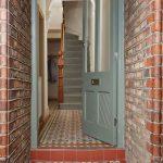 Entrance Foyer, Orange Blue Pattern Floor, Terracotta Open Wall