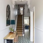 Entrance Foyer, White Wall, Patterned Floor, Wooden Console Table, Blue Table Lamp, Golden Metal Pendant