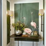 Flamingo Wallpaper Accent Wall, Green Accent On The Side, White Framed Wall, Thin Wooden Console Table, Sconces, Pendant