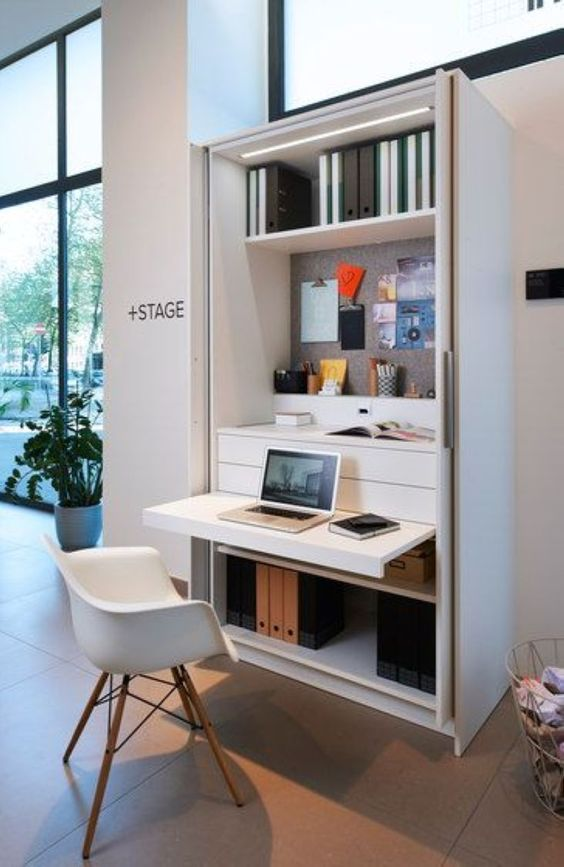 foldable study in a white cupboard, built in shelves, white modern chair