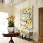 Foyer, White Wooden Wall, Small Beige Bench, Round Wooden Table, Chandelier