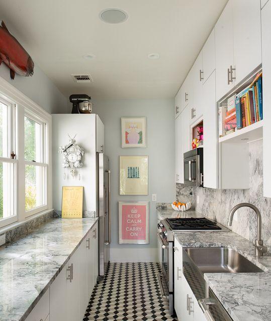 galley kitchen, black white floor tiles, white cabinet, grey marble top, grey marble backsplash, blue wall