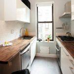 Galley Kitchen, Grey Floor, White Wall, White Cabinet, Dark Wood Kitchenette, Window