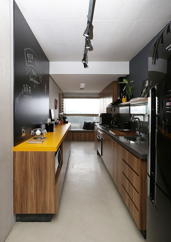 galley kitchen, white floor, black wall, wooden bottom cabinet, black top cabinet, yellow top, black frige, seating nook