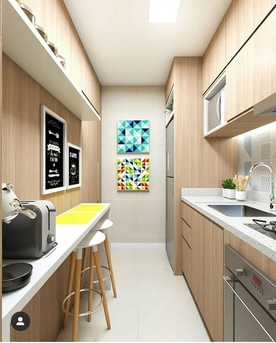 galley kitchen, white floor, wooden wall, pale backsplash tiles, white tall and thin table with bar stools