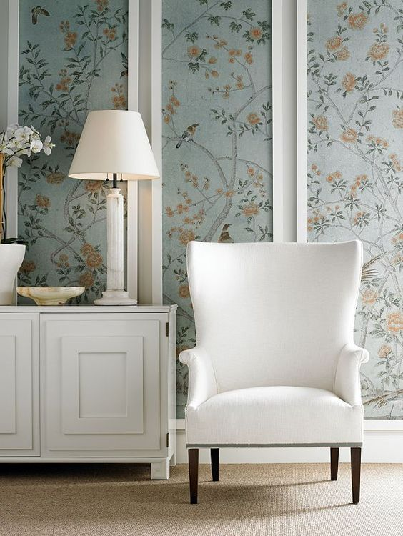 green wall accent, white wall, white cabinet, white table lamp, white chair, brown rug