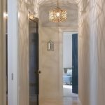 Hallway, Light Floor, White Wall, Small Dome Ceiling, Pendnats With Complicated Metal Frame