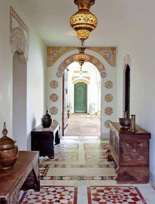 hallway, patterned floor tiles, white wall, moroccan lamp, wooden cabinet, wooden console tables