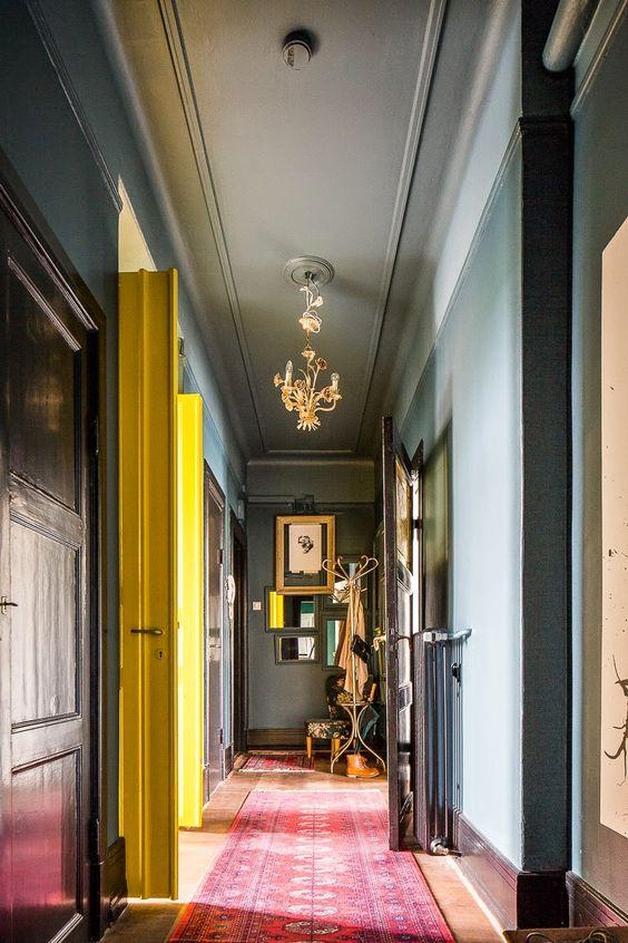 hallway, soft blue wall, pink carpet, yellow door