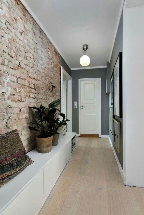 hallway, wooden floor, exposed wall, grey wall, white door, white ball pendant