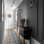 Hallway, Wooden Floor, White Wainscoting, Black Wall, Sconces, Black Cabinet, Rug, White Accent