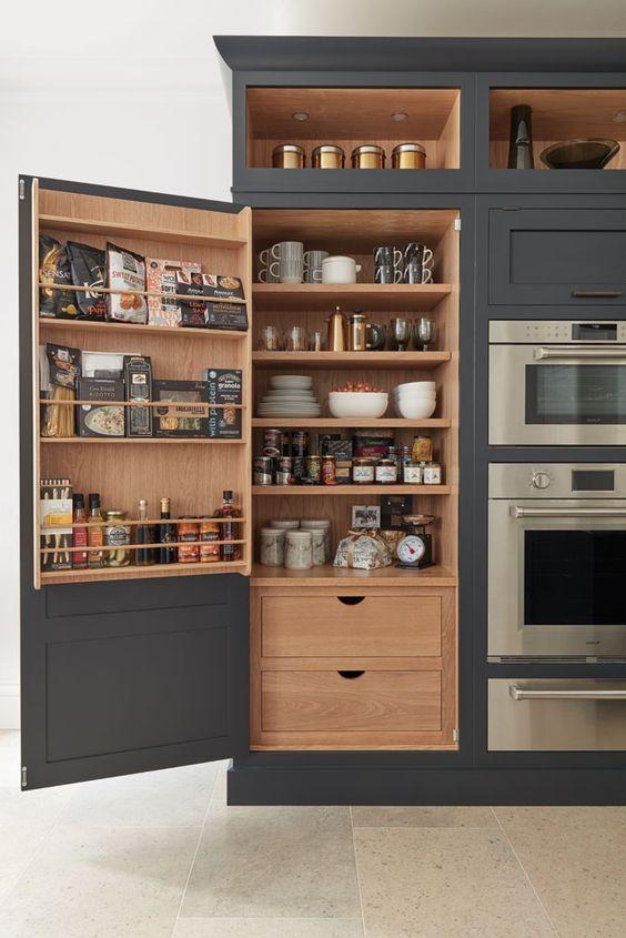 kitchen, beige floor tiles, black cupboard, shelves, drawers