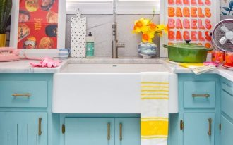 kitchen, black white checkered floor, flowery wallpaper, blue cabinet, white top, white sink