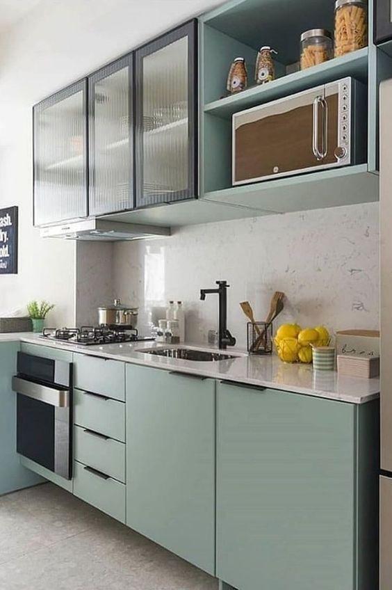 kitchen, grey floor, white backsplash, green bottom cabinet, green upper cabinet, white marble top