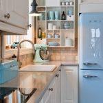 Kitchen, Grey Floor, White Bottom Cabinet, White Upper Cabinet, Silver Top, White Floating Shelves, Brown Backsplash, Blue Fridge