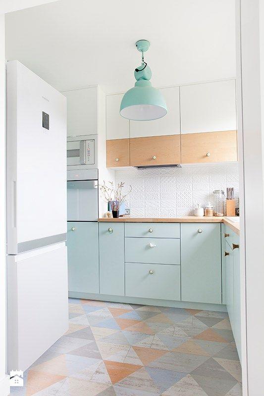 kitchen, light colorful floor, white wall, white upper cabinet, light green bottom cabinet, white backsplash