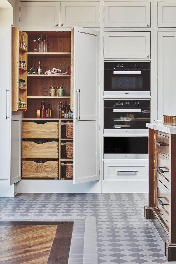 kitchen, patterned floor tiles, white built in cupboard, drawers, shelves inside
