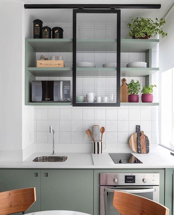 kitchen, white backsplash, green cabinet, white kitchen top, green floating shelves
