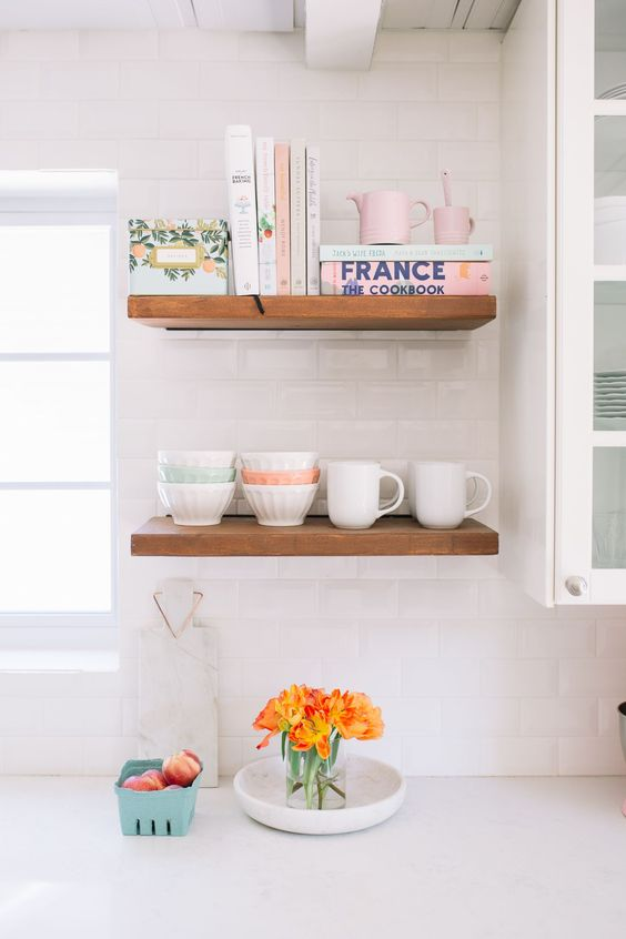 kitchen, white subway wall tiles, open shelves near the window, white upper cabinet with glass door