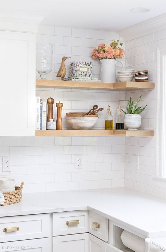 kitchen, white subway wall tiles, white bottom cabinet, white top, wooden corner open shelves, white upper cabinet