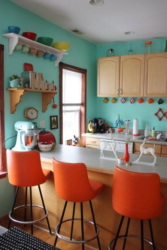 kitchen, wooden floor, brown wooden cabinet, blue wall, floating shelves, orange stool