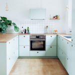 Kitchen, Wooden Floor, Light Green Bottom Cabinet, White Backsplash, White Wall