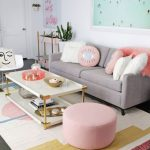 Living Room, Grey Floor, White Colorful Rug, White Coffee Table, Pink Round Ottoman, White Modern Chair, Grey Sofa, White Wall