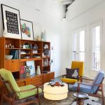 Living Room, Grey Seamless Floor, White Wall, Wooden Shelves, Yellow Chair, Blue Chair, Green Chair, Light Yellow Ottoman
