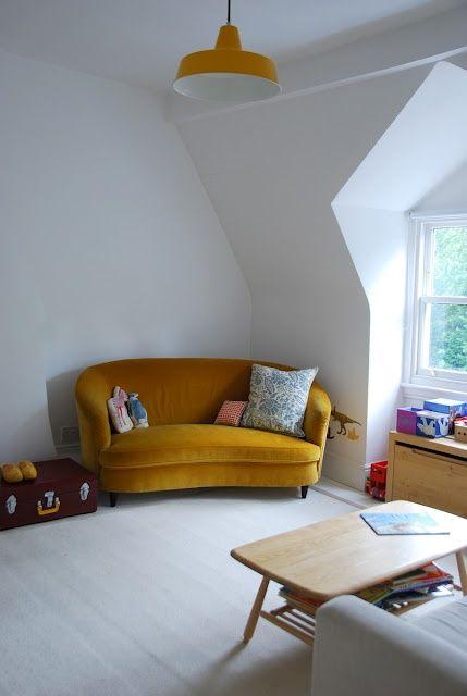 living room, light wooden floor, white wall, windows, mustard velvet sofa, wooden cofee table, grey chairs, wooden cabinet