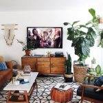 Living Room, Patterned Rug, White Wall, Wooden Chairs With Blak Cushion, White Rectangle Coffee Table, Brown Leather Sofa, Brown Wooden Cabinet