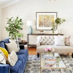 Living Room, White Rug With Blue Pattern, White Wall, White Sofa With Tufted Back, Blue Sofa, Glass Coffee Table, Console Table